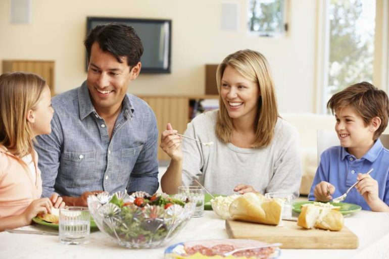 Family sharing meal at dinning table